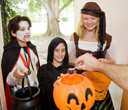 Trick or Treaters at Door. Adorable trick or treaters in the doorway waiting for candy Royalty Free Stock Photography