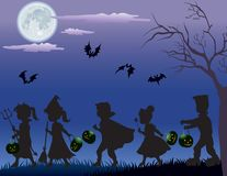 Trick Or Treaters At Night Stock Images