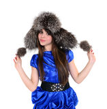 Tricke and young lady in fur hat standing and holding pompons in Stock Images