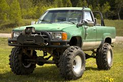 Tricked out 4x4. With lift kit, large mud tires, winch, roll bar, and a snorkel air intake Stock Image