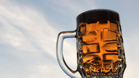 A trickle of bubbles rising in the beer. A mug of cold light beer stock video footage