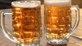 A trickle of bubbles rising in the beer. A mug of cold light beer stock video