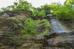 Trickling Waterfall Shale Cliffs Stock Images