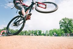 Tricks on the bike. young man jumps on a mountain bike. Cycling Sports Concept. Tricks on the bike. A young man jumps on a mountain bike. Cycling Sports Concept royalty free stock photography