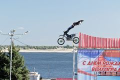 Tricks on a motorcycle jump performed by the athletes during the Stock Photo