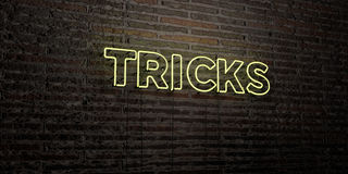 TRICKS -Realistic Neon Sign on Brick Wall background - 3D rendered royalty free stock image Royalty Free Stock Image