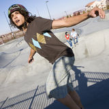 Tricks at the skatepark. Teen skater does tricks at the skate park with his friends Royalty Free Stock Photos