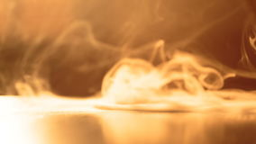 Tricks with smoke. Man arranges a mini tornado on the table. hookah smoking stock footage