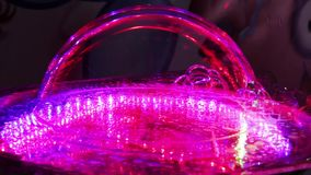 Tricks with soap bubbles. On illuminated surface many soap bubbles stock video footage