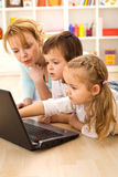 Tricks of the trade - kids learning computers Stock Images