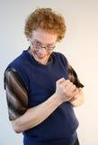 Trickster que fricciona suas mãos Fotografia de Stock