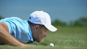 Tricky man blowing golf ball in hole, agility and cunning success strategy hobby. Stock footage stock video footage