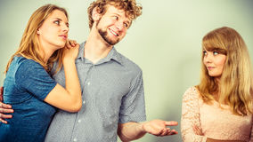 Tricky man cheating women Royalty Free Stock Photos
