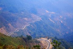 Tricky, sharp curve, s-curve road on mountain to Luang Pra Bang Laos. Tricky and sharp curve, s-curve road on mountain to Luang Pra Bang Laos royalty free stock images