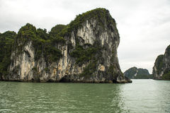 Tricky Waterway. Tricky passge between large rock formations in Ha Long Bay, Viet Nam Stock Photo
