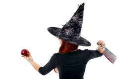 Tricky witch offering a poisoned apple, Halloween theme. Isolated on white Stock Photos