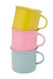 Tricolor de tazas apiladas en el fondo blanco aislado incluya Foto de archivo libre de regalías