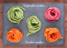 Tricolor Italian homemade noodles Stock Photos