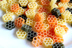 Tricolor pasta. Uncooked tricolor pasta royalty free stock photography