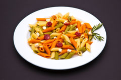 Tricolor pasta dish. On dark background royalty free stock images