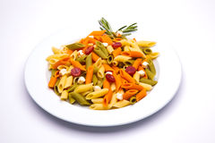 Tricolor pasta dish. On white background stock photography