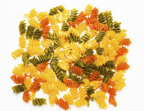 Tricolor Pasta fusilli pile on white background Royalty Free Stock Photography