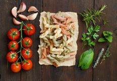 Tricolor pasta, vegetables and herbs royalty free stock photos