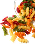 Tricolor pasta on white. Colorful dry pasta in a jar on white background Stock Images