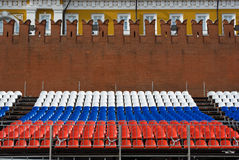 Tricolor seats and Kremlin wall fragment. Fragment of stand with tricolor seats (colored like Russian flag) near the Kremlin Wall set for 65th Victory day Royalty Free Stock Image