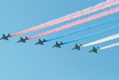 Tricolor traces of the 6 planes on the sky. Traces of the 6 planes on the sky in the form of the russian tricolor flag Royalty Free Stock Photo