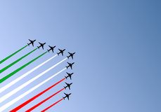 Tricolor wake. Illustration of nine airplanes flying in formation and making a tricolor wake Royalty Free Stock Photos