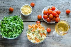 Tricolore farfalle with arugula, parmesan and cherry tomatoes Royalty Free Stock Photo