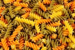 Tricolore Fusilli Pasta Twists. Uncooked tricolore fusilli pasta twist shapes background royalty free stock photography