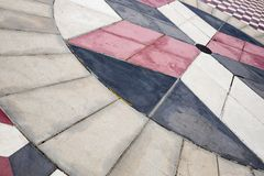 Tricolored tiles in a square in Villa de Valverde royalty free stock photography