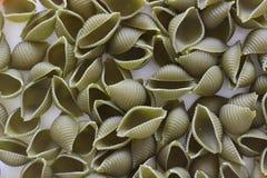 Tricolors pasta, italiensk pasta, vanlig pasta, kortkort beskjuter pasta, Arkivfoto