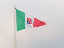 Tricolour triangular flag of Italian republic fluttering in the Stock Photos