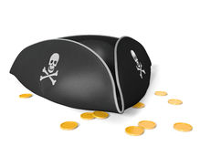Tricorn pirate hat with skull and bones, sitting on gold treasure Royalty Free Stock Image