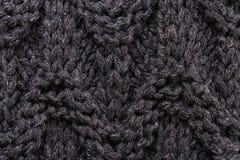 Tricottare colore scuro di struttura del fondo. Knit di alta risoluzione corteggia Fotografie Stock