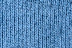 Tricottare la lana del blu del modello Immagini Stock