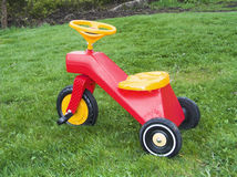 Tricycle. Plastic tricycle on green grass stock images
