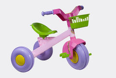Tricycle. Pink Tricycle for girls isolated in withe Royalty Free Stock Photography