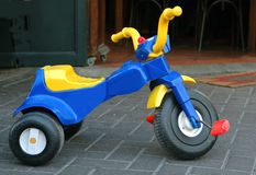 Tricycle. Colorful kid's tricycle royalty free stock image