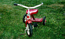 Tricycle. Old red Tricycle royalty free stock image