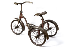Tricycle. Old and rust iron tricycle Stock Images