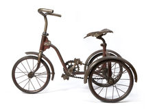 Tricycle. Old and rust iron tricycle Stock Photography