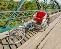 Tricycle bicycle on old  bridge Royalty Free Stock Photography