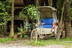 Tricycle bicycle taxi parking Stock Images