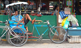 Tricycle bicycle taxi parking at the street Stock Photography