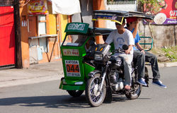 Tricycle cab driver Stock Photos