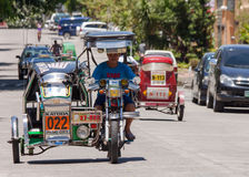 Tricycle cab driver Royalty Free Stock Photo